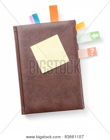 Planner with sticky note on a white background