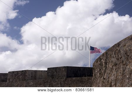 Flag Waves Over Historic Military Fort.