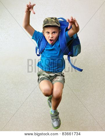 Schoolboy With Backpack Jumping And Running