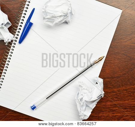 Lined note book over the table