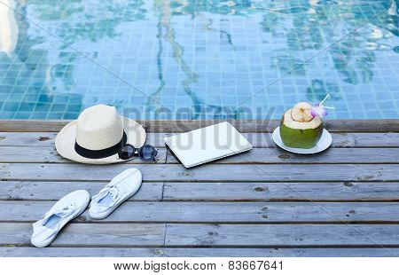 Laptop And Coconut Drink By Awimming Pool