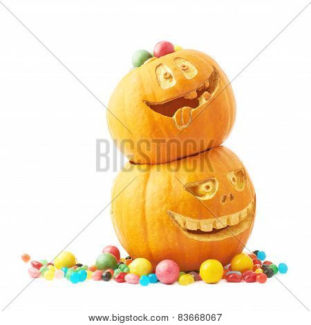 Two Halloween pumpkins filled with candies