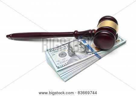 Gavel Lying On A Big Stack Of Money Isolated On White Background
