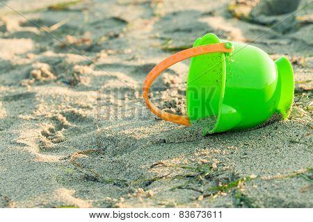 Toy Bucket On A Beach