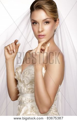 Portrait Of  Young Woman In Wedding Dress Posing With White Brid