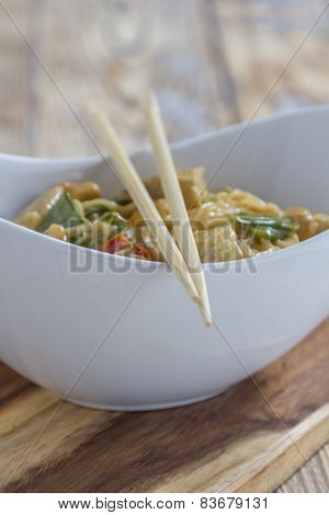 Bowl With Asian Noodles Chicken And Chopsticks