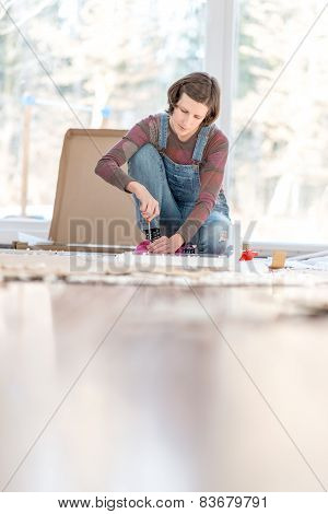 Woman Doing DIY Repairs At Home