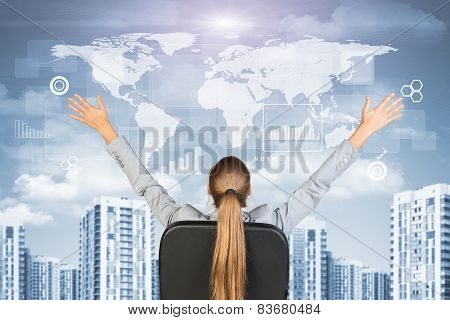 Businesswoman sitting with her hands outstretched against urban background