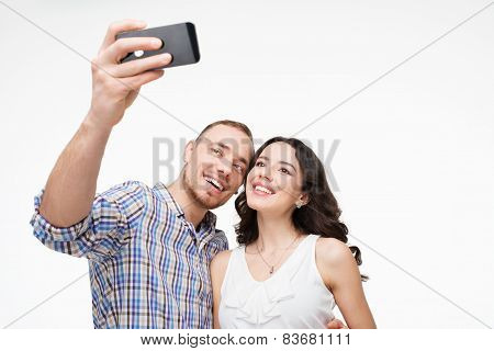 Smiling and happy lovers making selfie