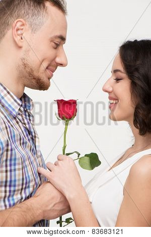 Man giving a rose to his beloved