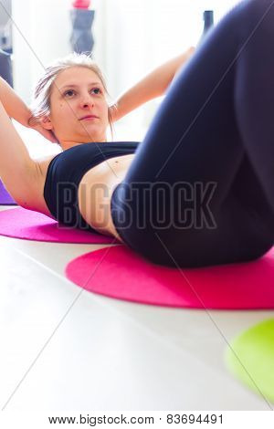 Girl doing crunches in living room
