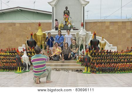 People photograph at the statue of King Naresuan the Great in Suphan Buri, Thailand.