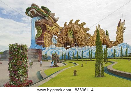 People walk in front of the Dragon Descendants museum in Suphan Buri, Thailand.