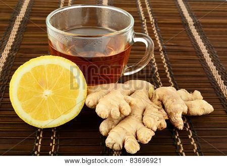 Ginger Tea On Brown Mat With Lemon