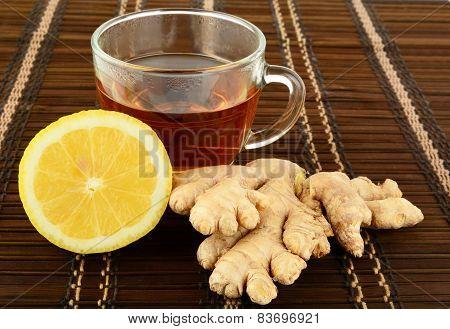 Ginger Tea On Brown Mat With Lemon