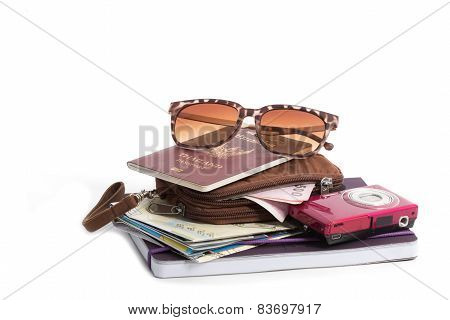 Preparation For Travel, Pocket Money, Passport, Road Map,camera And Sunglass On Isolate