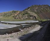 stock photo of shan  - Road to Ala Archa national park in Tian Shan mountain range in Kyrgyzstan - JPG
