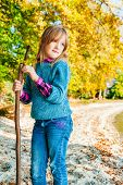 stock photo of pullovers  - Autumn portrait of a cute little girl - JPG
