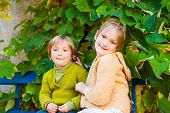 stock photo of pullovers  - Adorable children resting outdoors - JPG