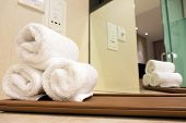 pic of motel  - White towels folded neatly in hotel bathroom - JPG