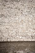 picture of paving stone  - Wall of stones and a stone paving - JPG