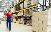 stock photo of warehouse  - long stack arrangement of goods in a wholesale and retail warehouse depot - JPG