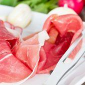 stock photo of smoked ham  - smoked ham on white plate close up - JPG