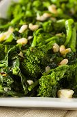 foto of sauteed  - Homemade Sauteed Green Broccoli Rabe with Garlic and Nuts - JPG