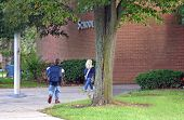 stock photo of school building  - Children walking into school building - JPG