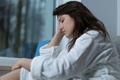 pic of lonely woman  - Photo of young pretty exhausted woman without energy - JPG