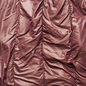 picture of down jacket  - Creased brown down jacket fragment as a background texture composition - JPG