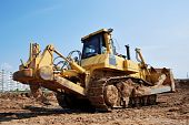 stock photo of ripper  - Bulldozer loader at earthmoving works over brigt sky with heavy ripper - JPG