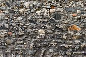foto of old stone fence  - pattern gray color of modern style design decorative uneven cracked real stone wall surface with cement - JPG