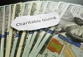 picture of cash  - Charitable Giving paper message on assorted cash - JPG