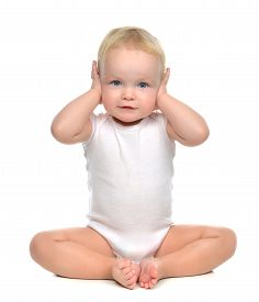 pic of infant  - infant child baby toddler sitting closed her hands over ears and hears nothing isolated on a white background - JPG