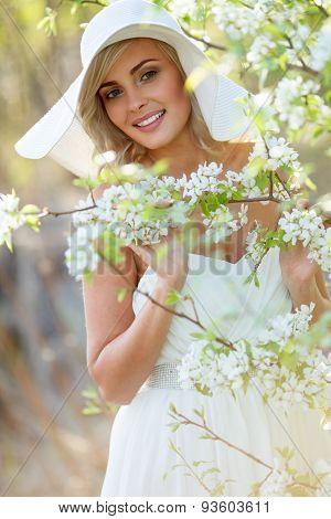 blonde woman in a flowered garden