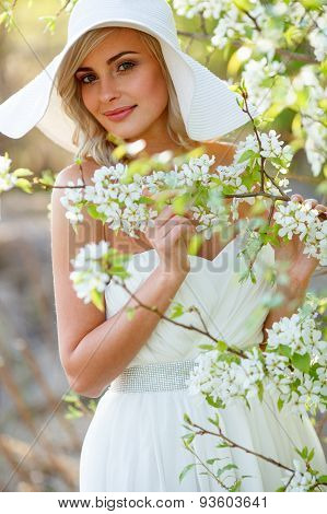 blonde woman in a flowered garden