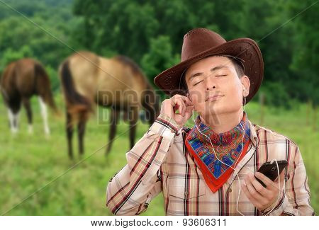 Cowboy enjoying podcasts on his smartphone