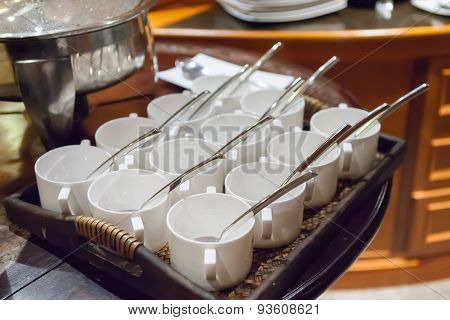 Rows Of Pure White Cup And Saucer With Teaspoon, Reflection On Table