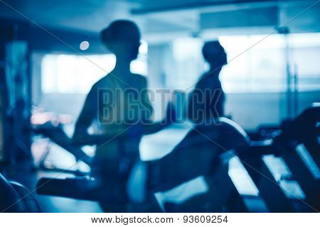 Outlines of girl and guy training on sports facilities in gym