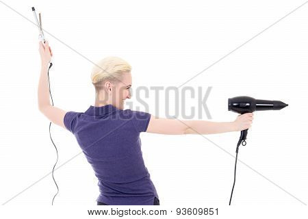 Back View Of Woman Hair Stylist Posing With Hairdryer And Curler Isolated On White