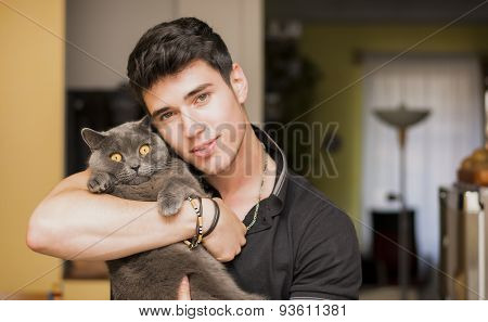 Handsome Young Man Hugging his Gray Cat Pet