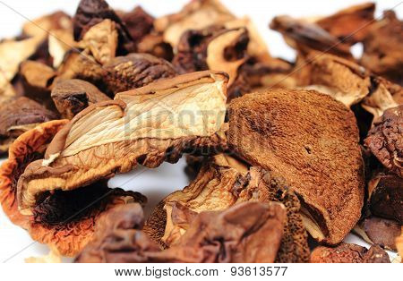 Heap Of Dried Mushrooms On White Background