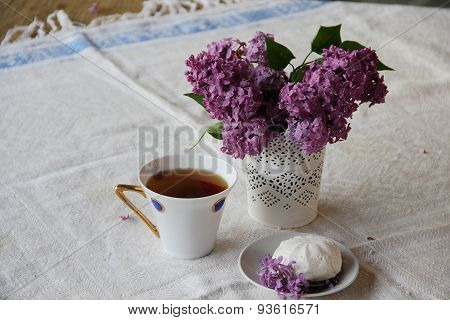 Still-life With A Lilac, A Zephyr And Tea In A Beautiful Cup