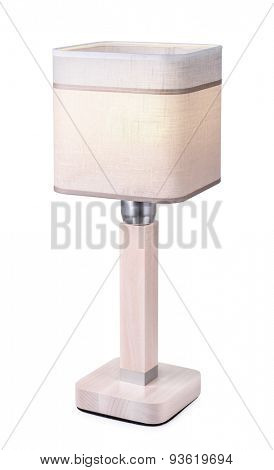 Table lamp with linen lampshade isolated on white