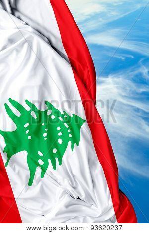 Lebanese waving flag on a beautiful day