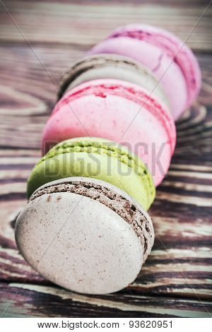 Macaroon On A Wooden Table. Focus On The Macaroon