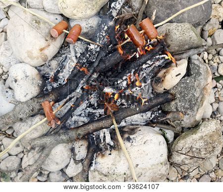 Many Sausage Cooking In The Fire At Summer Camp