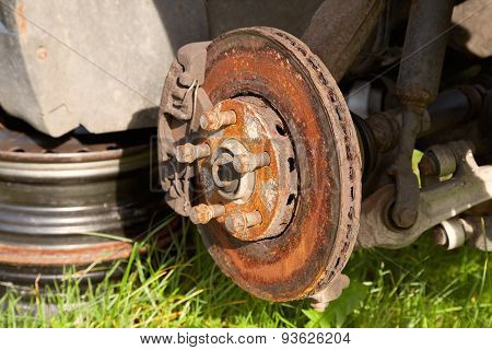 Front disk brake on car in process of damaged tyre replacement