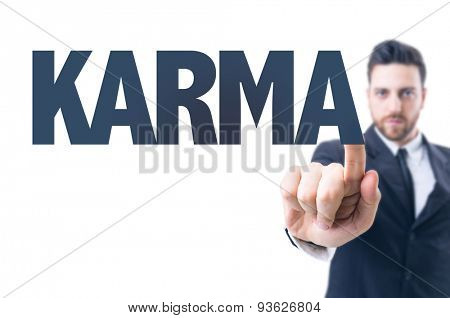 Business man pointing the text: Karma